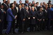 US President Barack Obama is greeted by world leaders as he arrives for the family photo at the COP21 United Nations Climate Change Conference in Le...