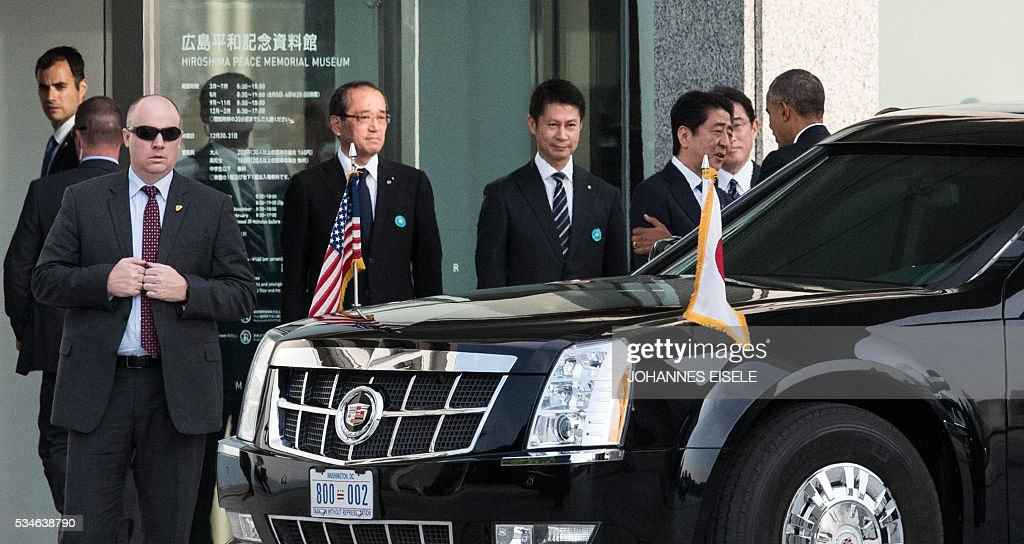 US President Barack Obama (L) is greeted Japanese Prime Minister Shinzo Abe upon arriving at the Hiroshima Peace Memorial park cenotaph in Hiroshima on May 27, 2016. Obama became the first sitting US leader to visit the site that ushered in the age of nuclear conflict. / AFP / JOHANNES