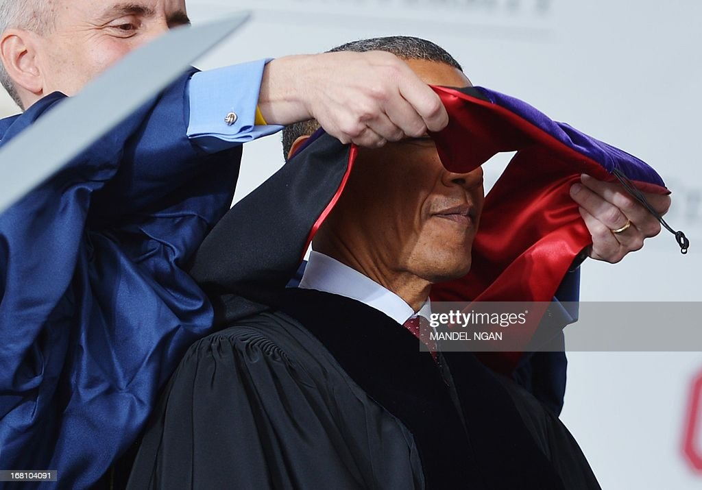 US President Barack Obama is hooded as he receives an honorary degree during the commencement ceremony at Ohio State University on May 5, 2013 in Columbus, Ohio. AFP PHOTO/Mandel NGAN