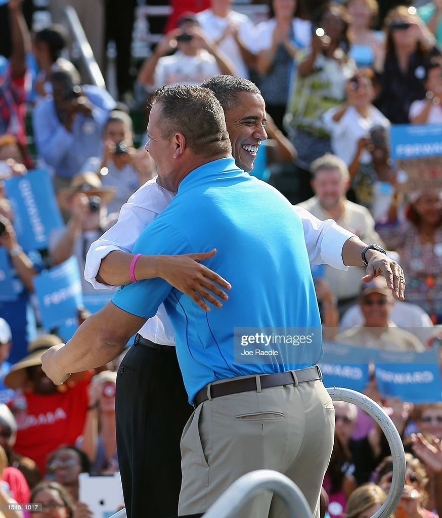 U.S. President <a gi-track='captionPersonalityLinkClicked' href=/galleries/search?phrase=Barack+Obama&family=editorial&specificpeople=203260 ng-click='$event.stopPropagation()'>Barack Obama</a> is hugged by pizza shop owner Scott Van Duzer as he introduces him during a campaign rally at the Delray Beach Tennis Center on October 23, 2012 in Delray Beach, Florida. Obama continues to campaign across the U.S. in the run-up to the November 6, presidential election.