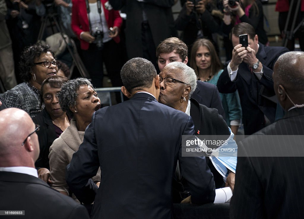 US President Barack Obama is kissed by a supporter after speaking at an event at the Decatur Community Recreation Center February 14, 2013 in Decatur, Georgia. Obama is traveling to Georgia to promote economic and educational initiatives he spoke about in this week's State of the Union. AFP PHOTO/Brendan SMIALOWSKI