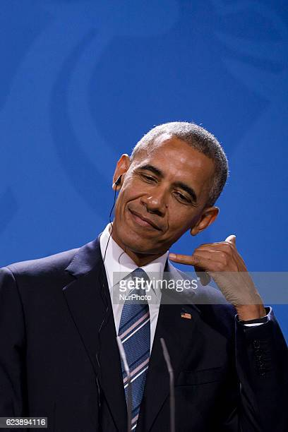US President Barack Obama is pictured during a news conference held with German Chancellor Angela Merkel at the Chancellery in Berlin Germany on...