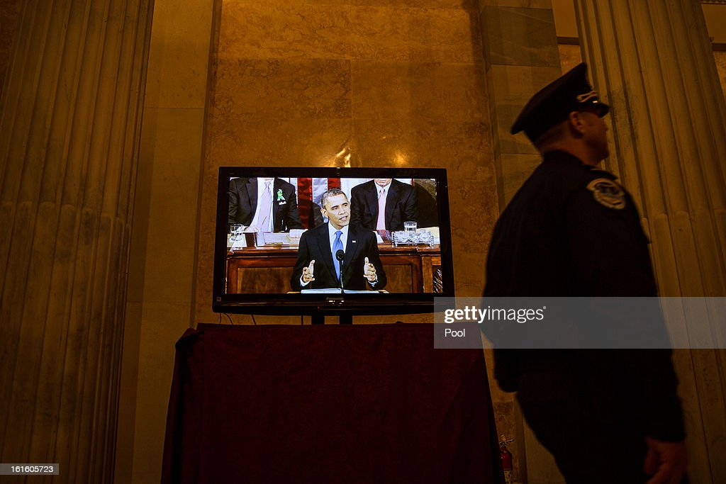 U.S. President Barack Obama is seen on a television screen in a hallway in the U.S. Capitol as he delivers his State of the Union Address February 12, 2013 in Washington, D.C. Facing a divided Congress, Obama focused his speech on new initiatives designed to stimulate the U.S. economy.