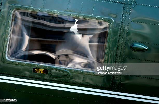 S President Barack Obama is seen on Marine One as it lands on the South Lawn of the White House July 10 2011in Washington DC President Obama returned...