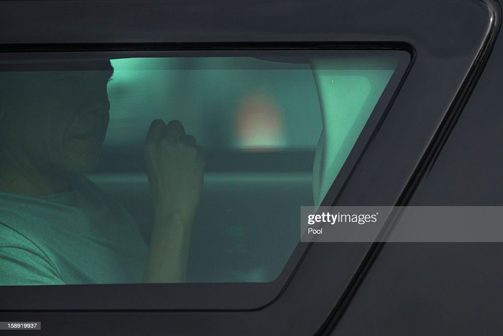 U.S. President Barack Obama is seen through the window of his motorcade vehicle returning to his vacation compound from his morning work out at Marine Corps Base Hawaii on January 3, 2013 in Kaneohe Bay, Hawaii. The president, having cut short his holiday vacation to work in Washington on efforts to avert the recent fiscal cliff crisis, returned to Hawaii on Wednesday to be with the first lady and and his daughters.