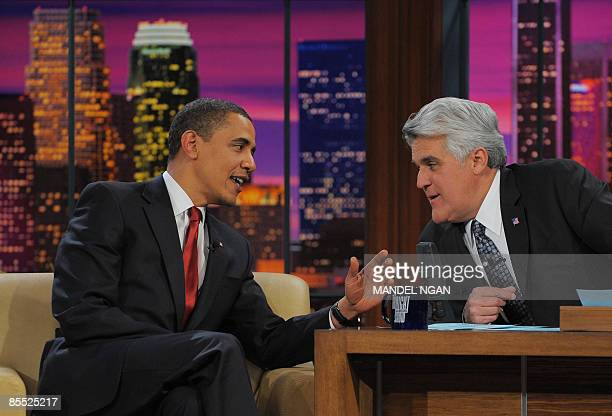 US President Barack Obama is seen with host Jay Leno during a taping of 'The Tonight Show' at NBC studios in Burbank California Obama has appeared on...