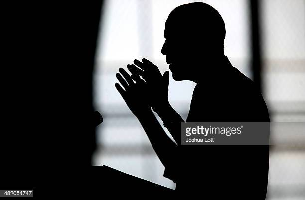 S President Barack Obama is silhouetted as he speaks about his proposal to raise the federal minimum wage at the University of Michigan on April 2...