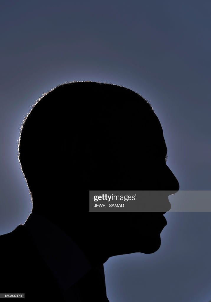 US President <a gi-track='captionPersonalityLinkClicked' href=/galleries/search?phrase=Barack+Obama&family=editorial&specificpeople=203260 ng-click='$event.stopPropagation()'>Barack Obama</a> is silhouetted as speaks during a ceremony at the Pentagon Memorial to mark the 12th anniversary of the 9/11 attacks in Washington, DC, on September 11, 2013. AFP PHOTO/Jewel Samad