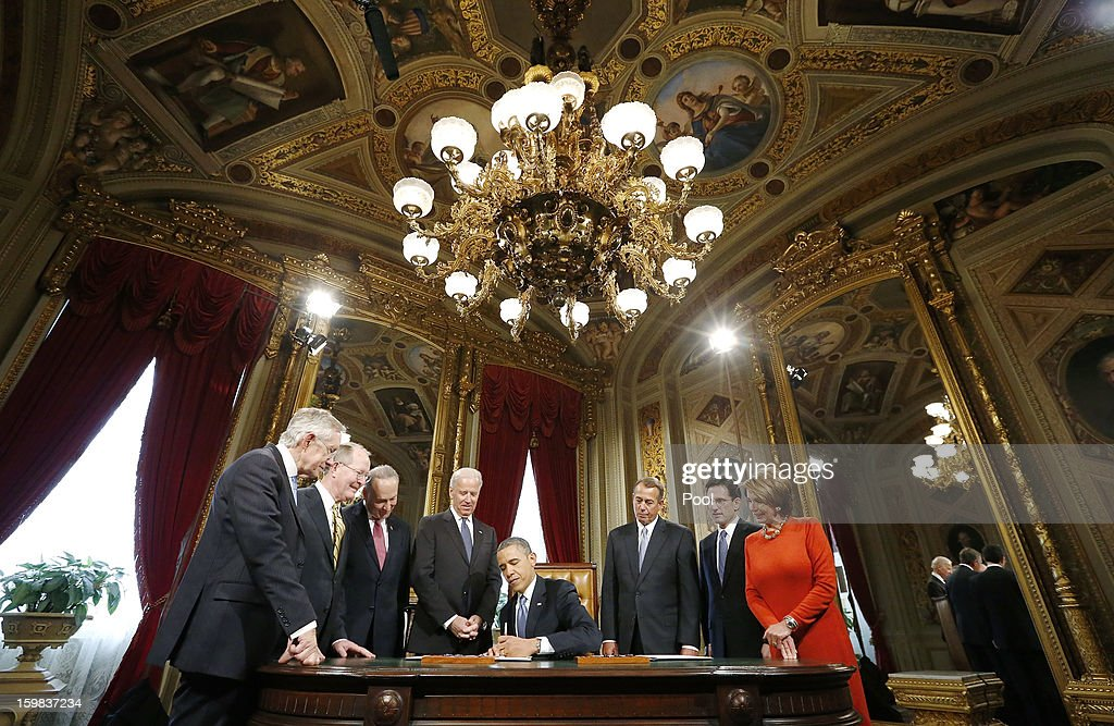 U.S. President Barack Obama (4R) is surrounded by (L-R) Senate Majority Leader Sen. Harry Reid (D-NV), Sen. Lamar Alexander (R-TN), Sen. Chuck Schumer (D-NY), Vice President Joe Biden, House Speaker Rep. John Boehner (R-OH), House Majority Leader Rep. Eric Cantor (R-VA) and House Minority Leader Rep. Nancy Pelosi (D-CA) while signing a proclamation to commemorate the inauguration, entitled a National Day of Hope and Resolve, directly after swearing-in ceremonies in the U.S Capitol on January 21, 2013 in Washington, DC. U.S. President Barack Obama was ceremonially sworn in for his second term today.