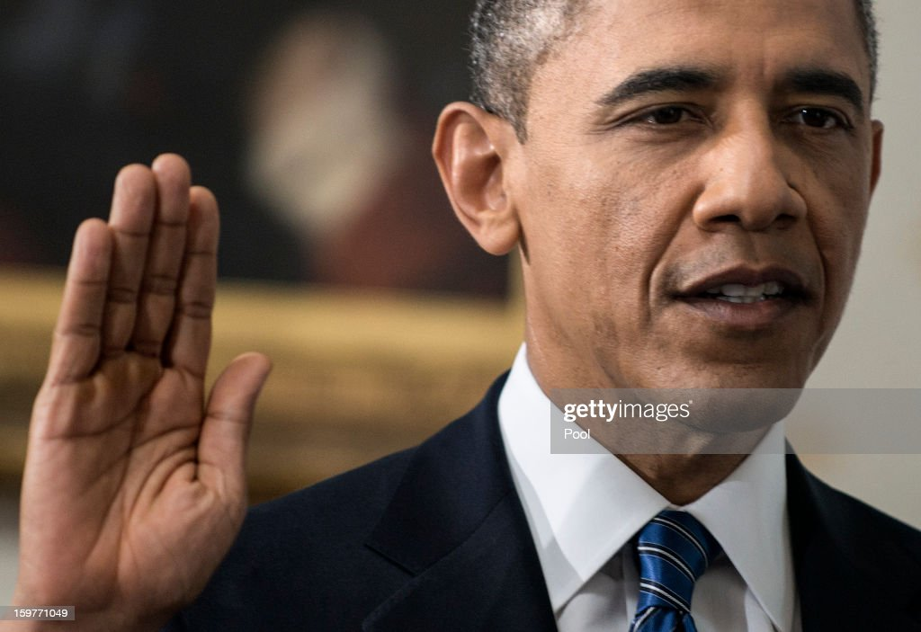 U.S. President <a gi-track='captionPersonalityLinkClicked' href=/galleries/search?phrase=Barack+Obama&family=editorial&specificpeople=203260 ng-click='$event.stopPropagation()'>Barack Obama</a> is sworn in by Chief Justice John Roberts Jr. in the Blue Room of the White House during the 57th Presidential Inauguration January 20, 2013 in Washington, D.C. Obama and U.S. Vice President Joe Biden were officially sworn in a day before the ceremonial inaugural swearing-in.