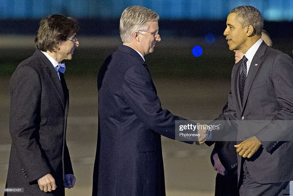US President Barack Obama is welcomed by King Philippe of Belgium (C) and Belgian Prime Minister Elio Di Rupo (L) as he disembarks from Air Force One at Zaventem Airport on March 25, 2014 in Brussels, Belgium. Obama is on a week-long trip during which he will visit the Netherlands, Belgium, Italy and Saudi Arabia.