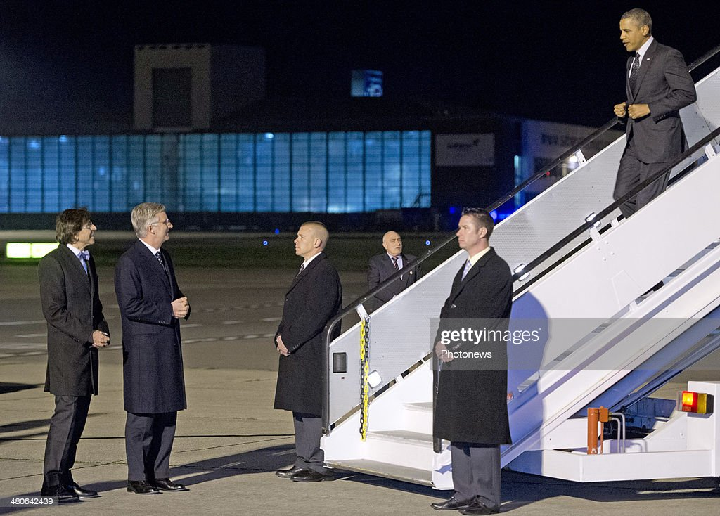 US President Barack Obama is welcomed by King Philippe of Belgium (2nd,L) and Belgian Prime Minister Elio Di Rupo (L) as he disembarks from Air Force One at Zaventem Airport on March 25, 2014 in Brussels, Belgium. Obama is on a week-long trip during which he will visit the Netherlands, Belgium, Italy and Saudi Arabia.