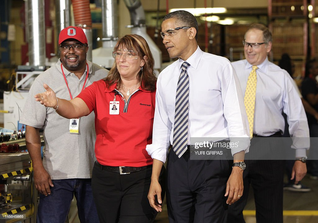 us president barack obama 2nd r is welcomed by production manager honeywell operating - Fashion Production Manager