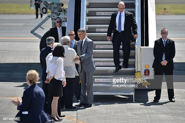 US President Barack Obama is welcomed on the tarmac upon his arrival at the international airport to attend the AsiaPacific Economic Cooperation...
