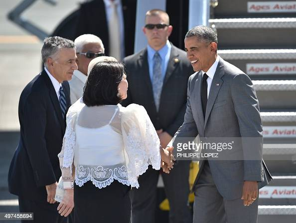 US President Barack Obama is welcomed upon his arrival at the international airport to attend the AsiaPacific Economic Cooperation Summit in Manila...