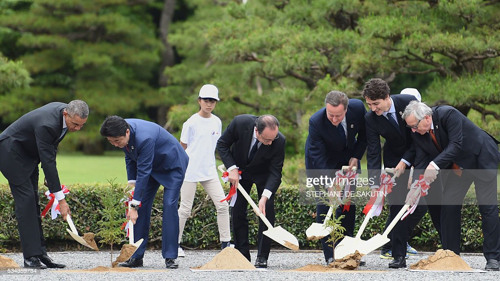 US President Barack Obama, Japan's Prime Minister Shinzo Abe, French President Francois Hollande, Britain's Prime Minister David Cameron, Canadian Prime Minister Justin Trudeau and European Commission President Jean-Claude Juncker take part in a planting ceremony on the grounds at Ise-Jingu Shrine in the city of Ise in Mie prefecture, on May 26, 2016 on the first day of the G7 leaders summit. World leaders kick off two days of G7 talks in Japan on May 26 with the creaky global economy, terrorism, refugees, China's controversial maritime claims, and a possible Brexit headlining their packed agenda. / AFP / STEPHANE