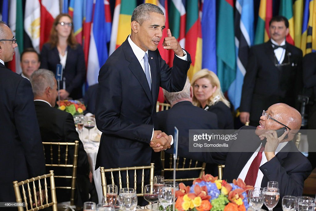 U.S. President Barack Obama (L) jokes with South African President Jacob Zuma, who was talking on the phone, during a luncheon hosted by United Nations Secretary-General Ban Ki-moon at the 70th annual UN General Assembly at the UN headquarters September 28, 2015 in New York City. Obama held a bilateral meeting with Indian Prime Minister Narendra Modi and with have a face-to-face meeting with Russian President Vladimir Putin later in the day.
