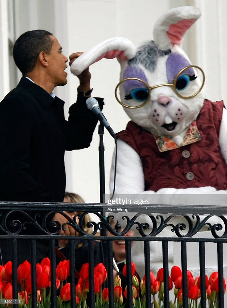 S President Barack Obama jokingly speaks into the ear of the Easter Bunny during a microphone failure prior to the start of the White House Easter...
