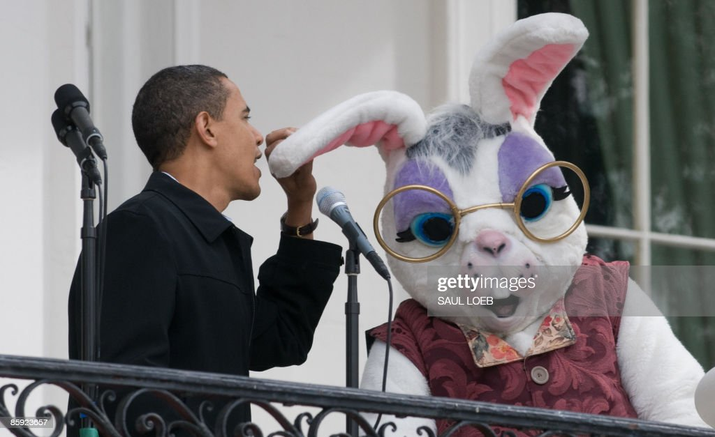 US President Barack Obama jokingly talks into the ear of a Easter Bunny after the microphones were not turned on during the annual White House Easter...
