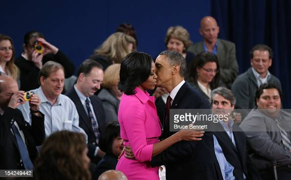 S President Barack Obama kisses his wife Michelle Obama after a town hall style presidential debate at Hofstra University October 16 2012 in...