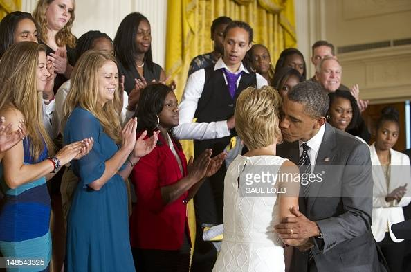 US President Barack Obama kisses team head coach Kim Mulkey during a ceremony honoring the 2012 NCAA Women's College Basketball Champion Baylor Bears...