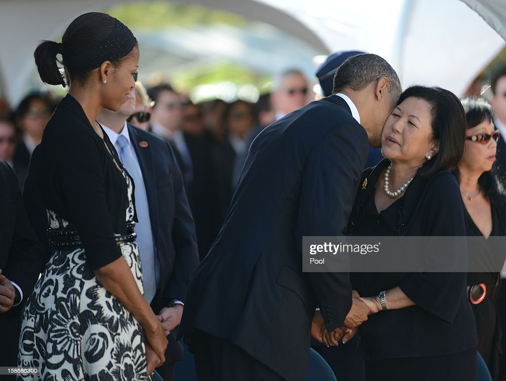 U.S. President <a gi-track='captionPersonalityLinkClicked' href=/galleries/search?phrase=Barack+Obama&family=editorial&specificpeople=203260 ng-click='$event.stopPropagation()'>Barack Obama</a> kisses the cheek of Senator Daniel Inouye's wife Irene Hirano as first lady <a gi-track='captionPersonalityLinkClicked' href=/galleries/search?phrase=Michelle+Obama&family=editorial&specificpeople=2528864 ng-click='$event.stopPropagation()'>Michelle Obama</a> looks on during the funeral services for the late Senator Daniel Inouye at the National Memorial Cemetery of the Pacific December 23, 2012 in Honolulu, Hawaii. Senator Inouye was a Medal of Honor recipient and a United States Senator since 1963.