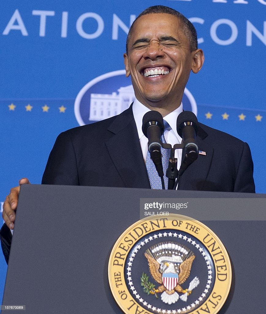 US President Barack Obama laughs as he arrives to speak to the 2012 Tribal Nations Conference at the Department of Interior in Washington, DC, on December 5, 2012. AFP PHOTO / Saul LOEB