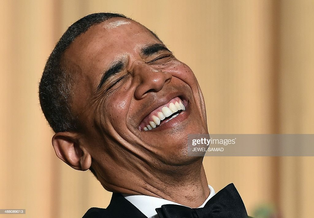 US President Barack Obama laughs as he listens performer Joel McHale telling jokes during the White House Correspondents Association Dinner on May 3, 2014 in Washington, DC. AFP PHOTO/Jewel Samad