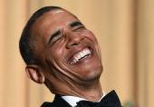 US President Barack Obama laughs as he listens performer Joel McHale telling jokes during the White House Correspondents Association Dinner on May 3...