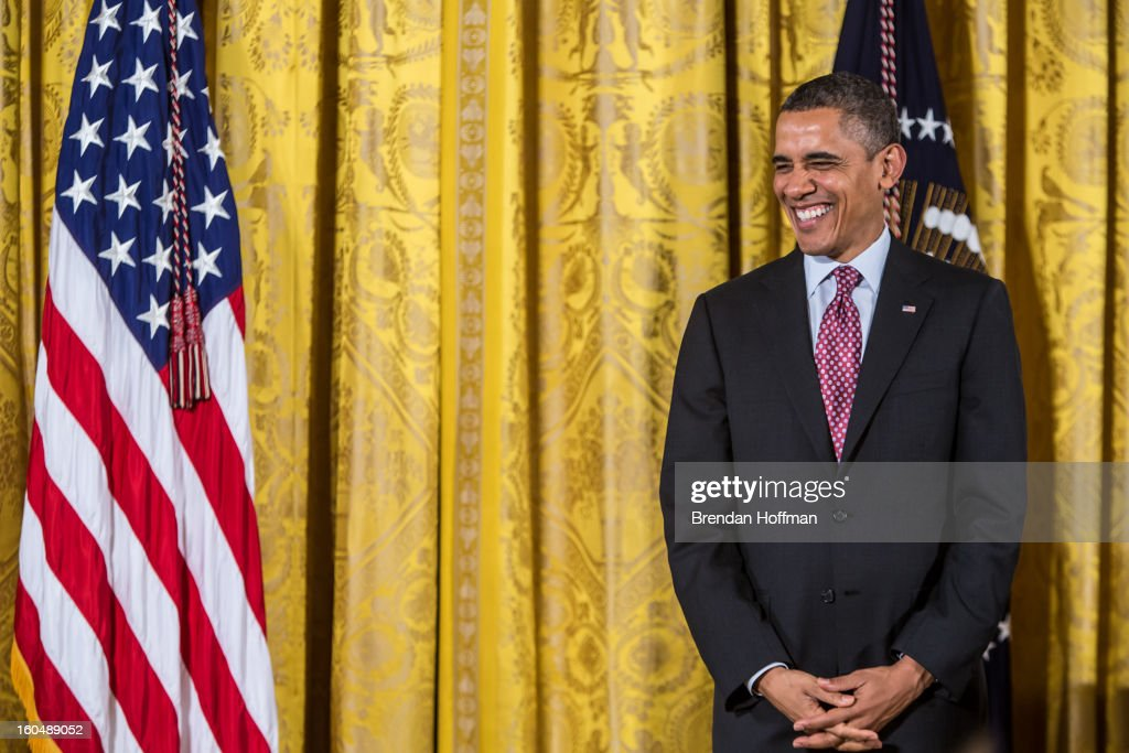 President <a gi-track='captionPersonalityLinkClicked' href=/galleries/search?phrase=Barack+Obama&family=editorial&specificpeople=203260 ng-click='$event.stopPropagation()'>Barack Obama</a> laughs during a ceremony awarding the National Medal of Technology and Innovation at the White House on February 1, 2013 in Washington, DC. The National Medal of Science recognizes individuals who have made outstanding contributions to science and engineering, while the National Medal of Technology and Innovation recognizes those who have made lasting contributions to America's competitiveness and quality of life and helped strengthen the Nation's technological workforce.