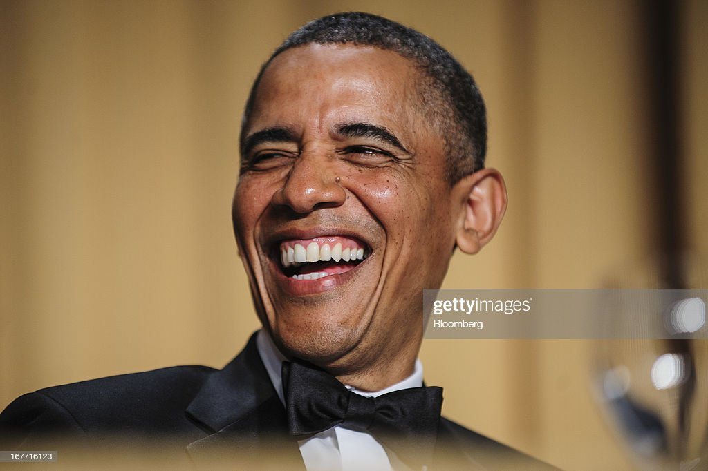 U.S. President <a gi-track='captionPersonalityLinkClicked' href=/galleries/search?phrase=Barack+Obama&family=editorial&specificpeople=203260 ng-click='$event.stopPropagation()'>Barack Obama</a> laughs during the White House Correspondents' Association (WHCA) dinner in Washington, District of Columbia, U.S., on Saturday, April 27, 2013. The 99th annual dinner raises money for WHCA scholarships and honors the recipients of the organization's journalism awards. Photographer: Pete Marovich/Bloomberg via Getty Images