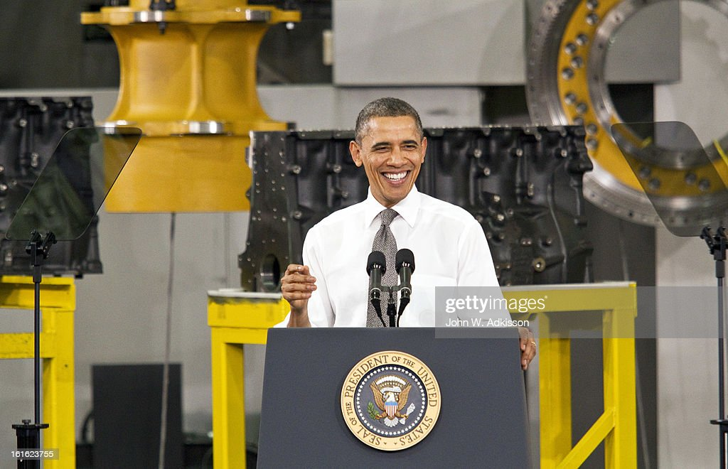 U.S. President Barack Obama laughs while delivering remarks on the economy at Linamar Corporation on February 13, 2013 in Arden, North Carolina. President Obama delivered the remarks at the North Carolina auto components manufacturing plant following his State of the Union speech on Tuesday.