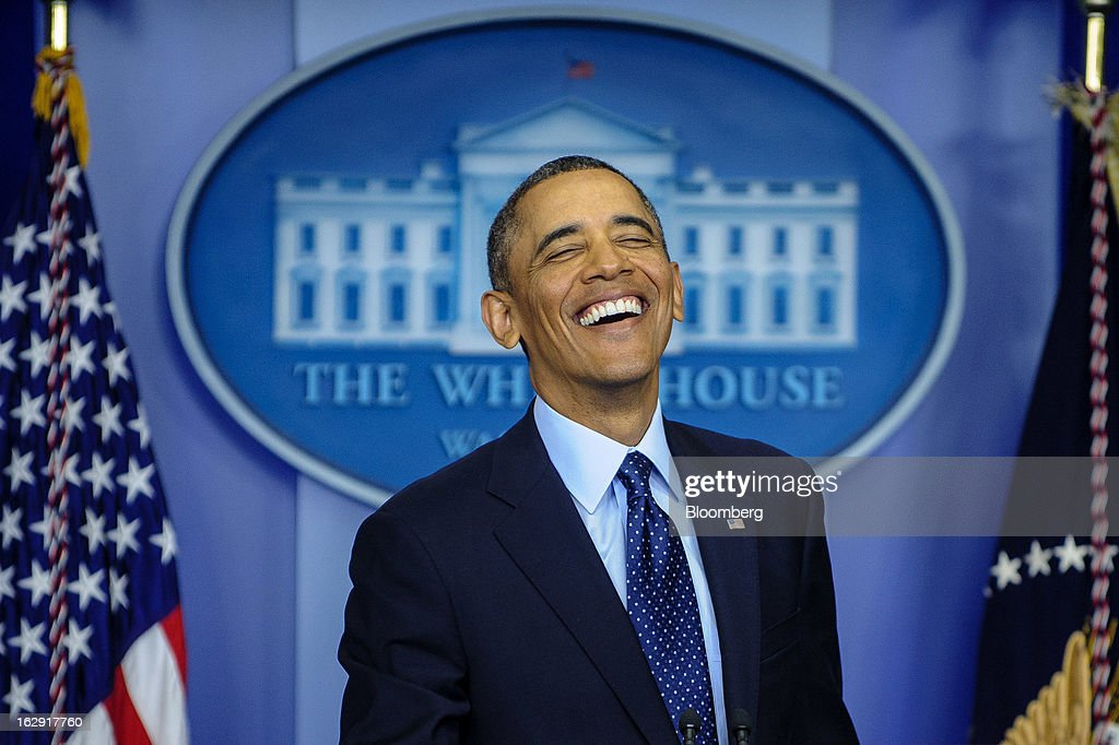 "U.S. President <a gi-track='captionPersonalityLinkClicked' href=/galleries/search?phrase=Barack+Obama&family=editorial&specificpeople=203260 ng-click='$event.stopPropagation()'>Barack Obama</a> laughs while speaking to the media in the Brady Press Briefing Room at the White House in Washington, D.C., U.S., on Friday, March 1, 2013. Obama said the automatic spending cuts set to kick in today will be a ""slow grind"" on the economy and that it may take weeks to win over enough lawmakers from both parties to reach a deal on a replacement deficit-cutting plan. Photographer: Pete Marovich/Bloomberg via Getty Images"