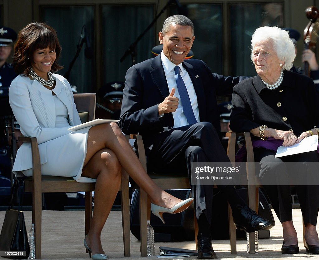 President Barack Obama laughs with his wife first lady Michelle Obama and former first lady Barbara Bush during the opening ceremony of the George W...