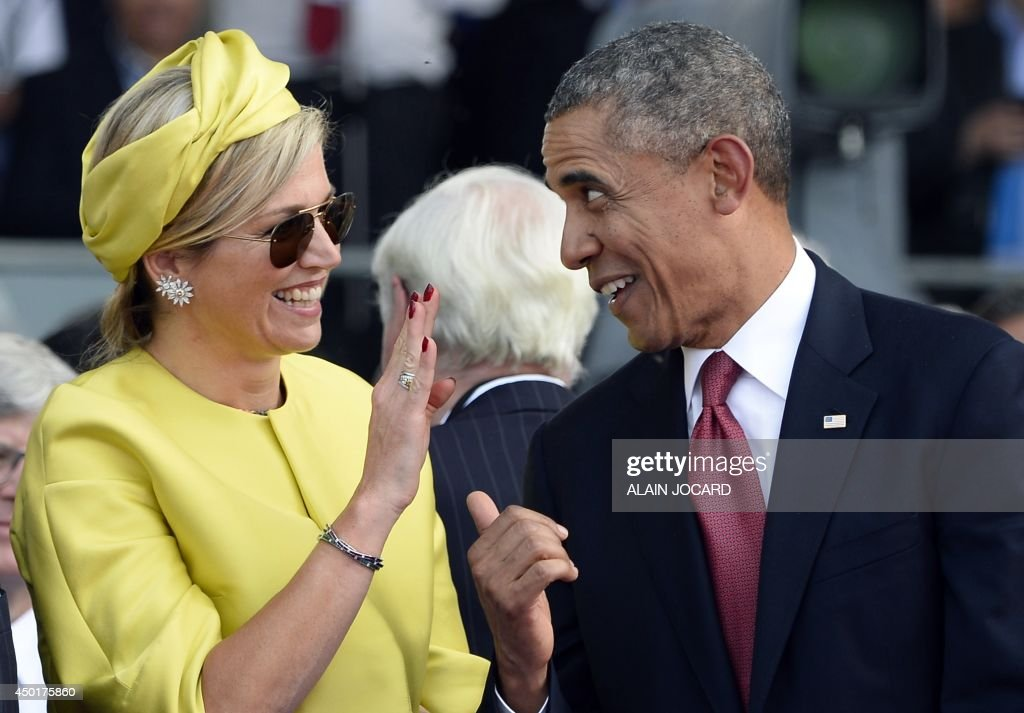 US President <a gi-track='captionPersonalityLinkClicked' href=/galleries/search?phrase=Barack+Obama&family=editorial&specificpeople=203260 ng-click='$event.stopPropagation()'>Barack Obama</a> (R) laughs with Queen Maxima of the Netherlands at the international D-Day commemoration ceremony in Ouistreham, on June 6, 2014, marking the 70th anniversary of the World War II Allied landings in Normandy.
