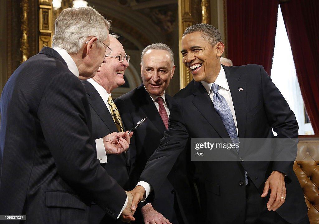 S President Barack Obama laughs with Senate Majority Leader Sen Harry Reid Sen Lamar Alexander and Sen Chuck Schumer after signing a proclamation to...