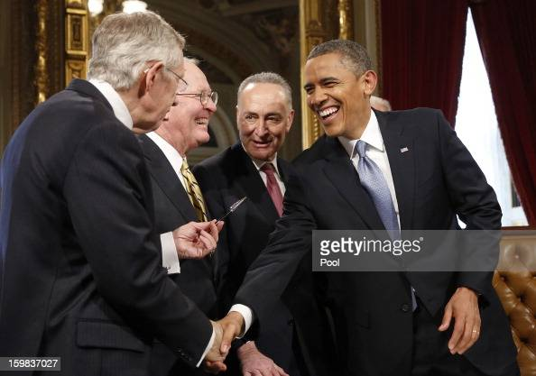 S President Barack Obama laughs with Senate Majority Leader Sen Harry Reid Sen Lamar Alexander and Sen Chuck Schumer after signing a proclamation to...