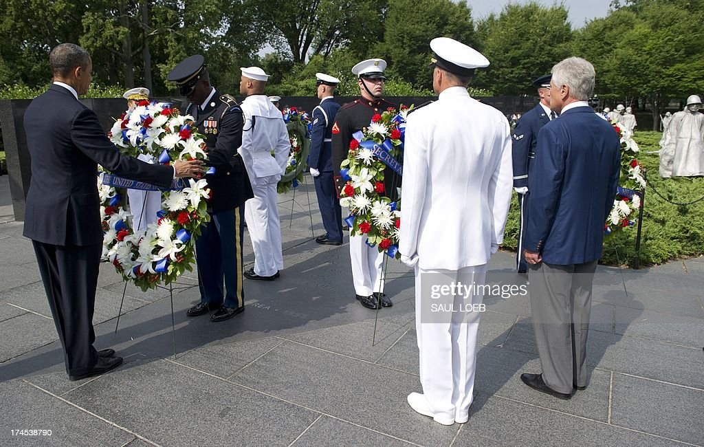 US President Barack Obama lays a wreath alongside US and Korean officials at the Korean War Veterans Memorial to commemorate the 60th anniversary of...