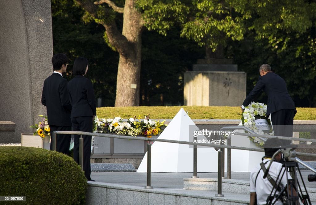 U.S. President Barack Obama (R) lays a wreath at the cenotaph in Hiroshima Peace Memorial Park to respect to the families of victims, killed by an atomic bomb in Hiroshima, Japan on May 27, 2016. US President Barack Obama is the first American president, visiting Hiroshima after United States of America dropped Atomic bomb in Hiroshima on August 6, 1945.