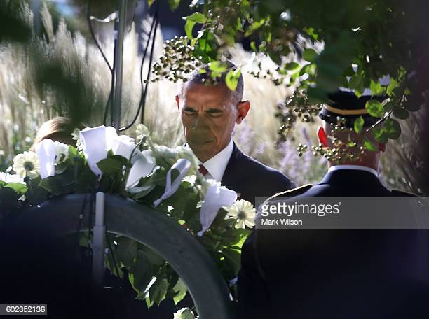 S President Barack Obama lays a wreath during a ceremony to mark the 15th anniversary of the 9/11 terrorists attacks at the Pentagon Memorial...