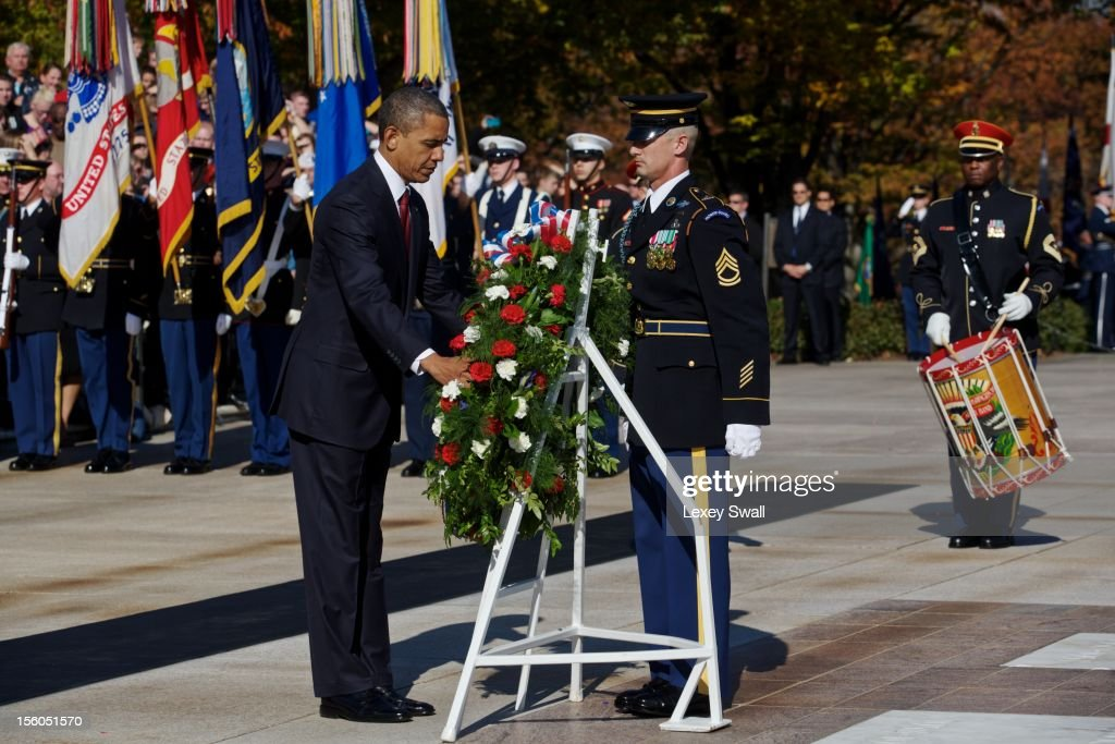 U.S. President Barack Obama lays a wreath in front of the Tomb of the Unknowns during the Presidential Wreath-Laying Ceremony at Arlington National Cemetery on November 11, 2012 Arlington, Virginia. Obama delivered remarks at the cemetery amphitheater after laying the wreath.