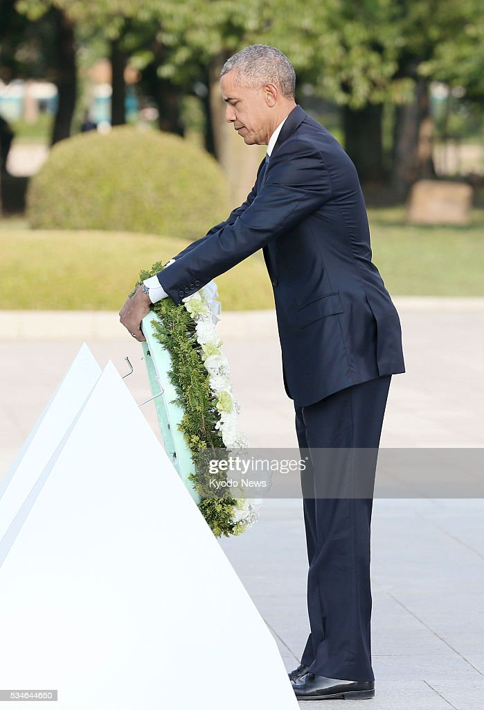 U.S. President <a gi-track='captionPersonalityLinkClicked' href=/galleries/search?phrase=Barack+Obama&family=editorial&specificpeople=203260 ng-click='$event.stopPropagation()'>Barack Obama</a> lays flowers at the cenotaph for atomic-bomb victims at the Peace Memorial Park in Hiroshima on May 27, 2016. Obama became the first sitting president to visit the atomic-bombed city.