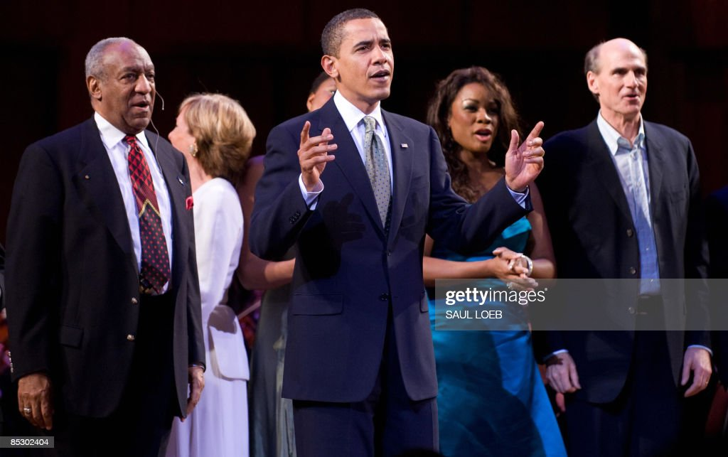 US President <a gi-track='captionPersonalityLinkClicked' href=/galleries/search?phrase=Barack+Obama&family=editorial&specificpeople=203260 ng-click='$event.stopPropagation()'>Barack Obama</a> leads the singing of Happy Birthday to Massachusetts Senator Ted Kennedy alongside <a gi-track='captionPersonalityLinkClicked' href=/galleries/search?phrase=Bill+Cosby&family=editorial&specificpeople=206281 ng-click='$event.stopPropagation()'>Bill Cosby</a> (L) and James Taylor (R) during a musical birthday salute to Kennedy at the Kennedy Center in Washington, DC, March 8, 2009. AFP PHOTO / Saul LOEB