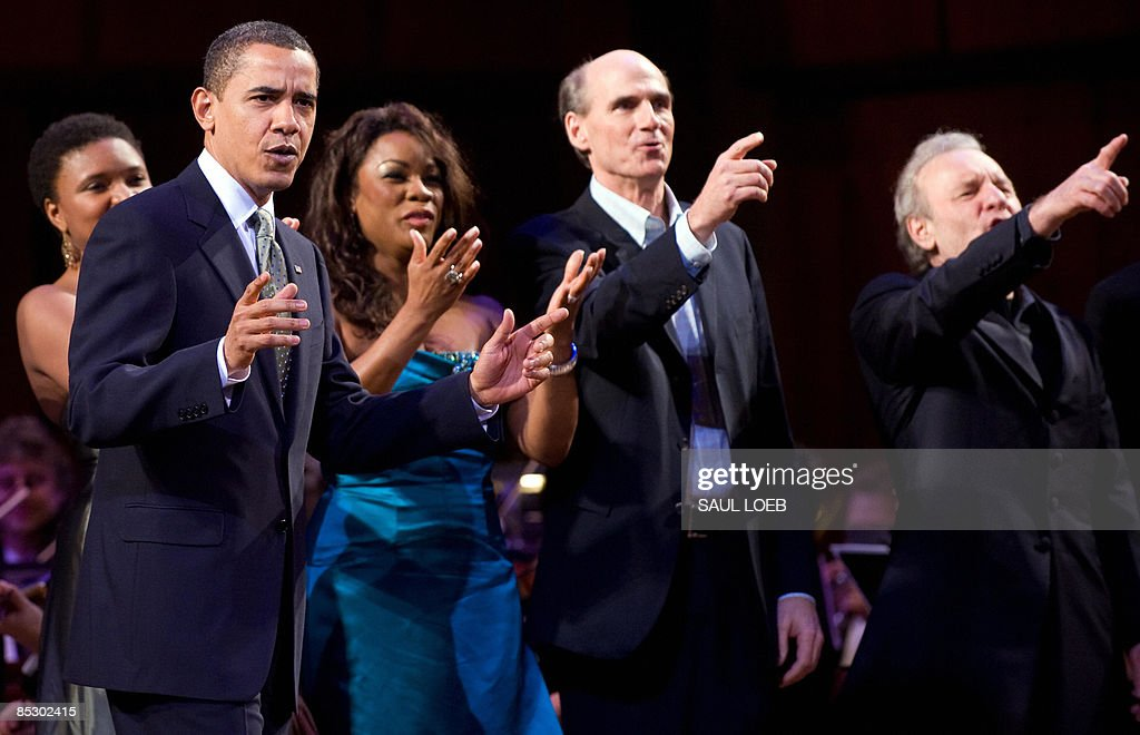 US President <a gi-track='captionPersonalityLinkClicked' href=/galleries/search?phrase=Barack+Obama&family=editorial&specificpeople=203260 ng-click='$event.stopPropagation()'>Barack Obama</a> leads the singing of Happy Birthday to Massachusetts Senator Ted Kennedy during a musical birthday salute to Kennedy at the Kennedy Center in Washington, DC, March 8, 2009. Standing alongside Obama are: Lizz Wright (L), Denyce Graves (C) and James Taylor (2nd R). AFP PHOTO / Saul LOEB