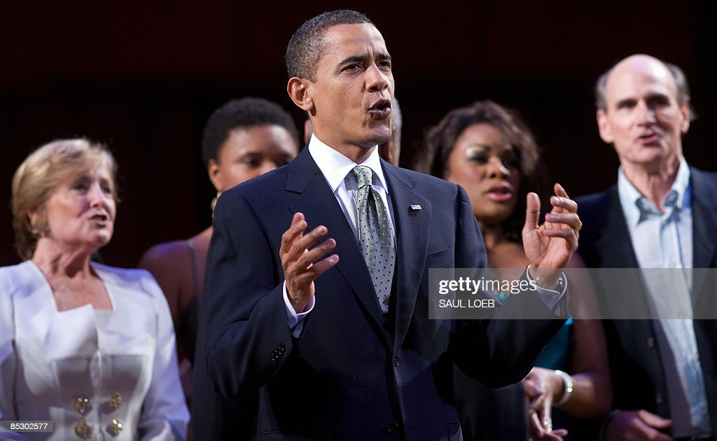 US President <a gi-track='captionPersonalityLinkClicked' href=/galleries/search?phrase=Barack+Obama&family=editorial&specificpeople=203260 ng-click='$event.stopPropagation()'>Barack Obama</a> leads the singing of Happy Birthday to Massachusetts Senator Ted Kennedy during a musical birthday salute to Kennedy at the Kennedy Center in Washington, DC, March 8, 2009. AFP PHOTO / Saul LOEB