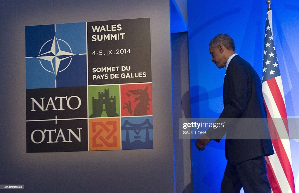 US President Barack Obama leaves a press conference on the second day of the NATO 2014 Summit at the Celtic Manor Resort in Newport South Wales on...