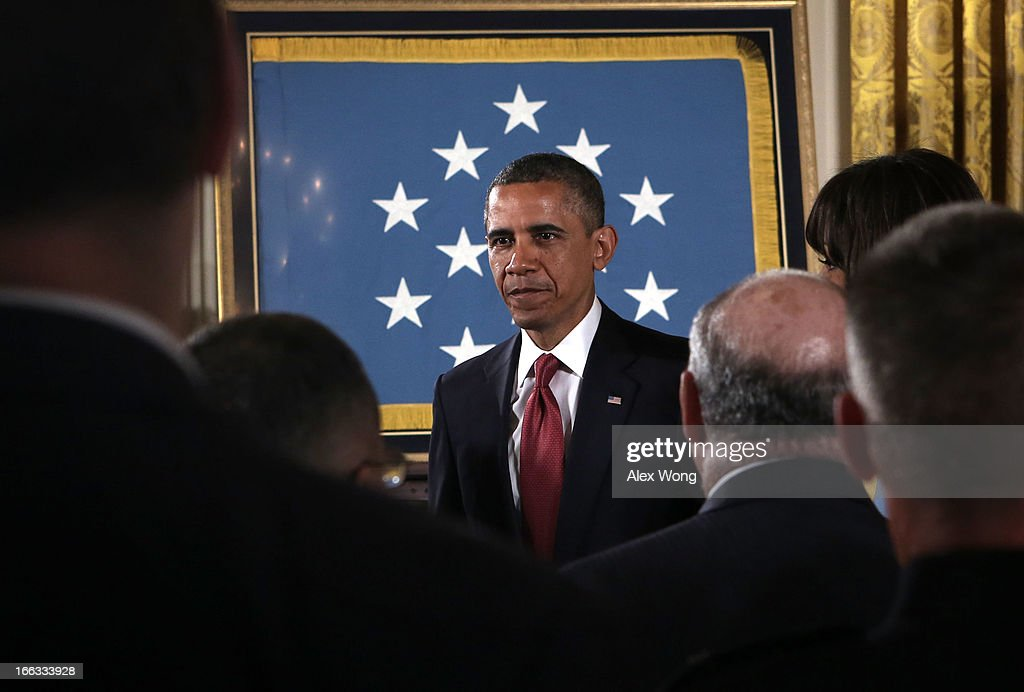 U.S. President <a gi-track='captionPersonalityLinkClicked' href=/galleries/search?phrase=Barack+Obama&family=editorial&specificpeople=203260 ng-click='$event.stopPropagation()'>Barack Obama</a> leaves after a Medal of Honor Ceremony April 11, 2013 at the East Room of the White House in Washington, DC. U.S. Army Chaplain (Captain) Emil J. Kapaun received the Medal of Honor for conspicuous gallantry posthumously for his extraordinary heroism while serving with the 3d Battalion, 8th Cavalry Regiment, 1st Cavalry Division during combat operations against an armed enemy at Unsan, Korea and as a prisoner of war from November 1-2, 1950.