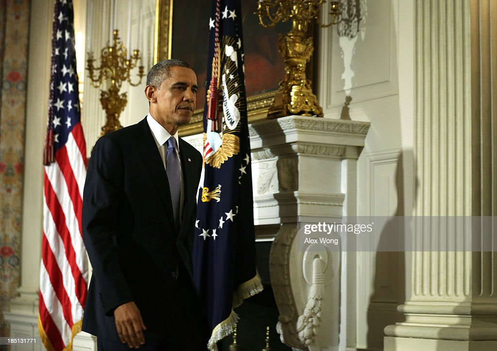 U.S. President <a gi-track='captionPersonalityLinkClicked' href=/galleries/search?phrase=Barack+Obama&family=editorial&specificpeople=203260 ng-click='$event.stopPropagation()'>Barack Obama</a> leaves after he made a statement at the State Dining Room of the White House October 17, 2013 in Washington, DC. Obama said the American people are completely fed up with Washington and called on cooperation to work things out.
