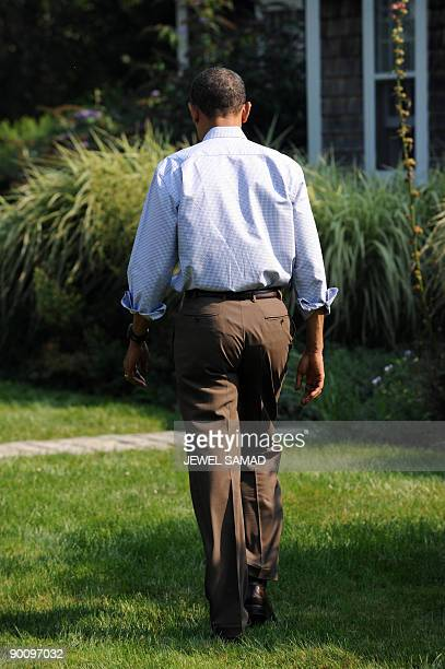 US President Barack Obama leaves after making a statement over the death of US Senator Edward Kennedy at the Blue Heron Farm in Oak Bluffs on...