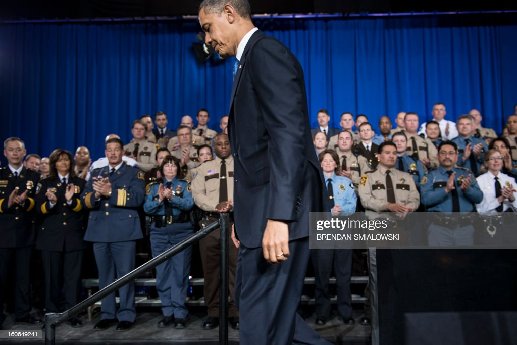 US President Barack Obama leaves after speaking about gun violence at the Minneapolis Police Department's special operations center on February 4, 2013 in Minneapolis, Minnesota. Obama spoke after meeting with local leaders and law enforcement to discuss gun violence and local efforts to control it. AFP PHOTO/Brendan SMIALOWSKI